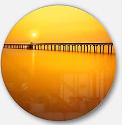 DESIGN ART Designart Yellow Tinged Seashore and Long Sea Pier and Bridge Metal Artwork Disc of 38 inch, 38 H x 38 W x 1 D, Orange