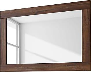 Ronde Spiegel Goud : Gouden frame naast cactus in grijs werkruimte interieur met ronde