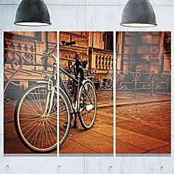 DESIGN ART Designart MT9402-3P Retro Bicycle Against Stone Landscape Photo Metal Wall Art (3 Panels), 28 H x 36 W x 1 D 3P, Brown