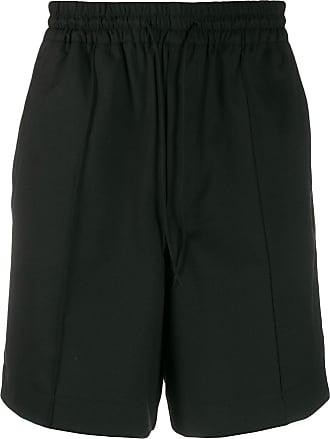 Yohji Yamamoto Calça esportiva com estampa logo - Preto