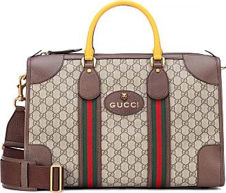 9645f1f54a Gucci Borsa da viaggio in tessuto GG Supreme e pelle