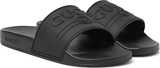 7ad9982b753 Gucci Logo-embossed Rubber Slides - Black