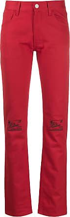 Raf Simons Calça jeans com detalhe floral nos joelhos - Vermelho
