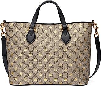 Gucci Borsa shopping in tessuto GG Supreme con api 7f9572e4a67