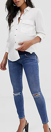 Asos Maternity ASOS DESIGN Maternity lisbon mid rise skinny jeans in mid wash blue with frayed knee rips and under the bump waistband