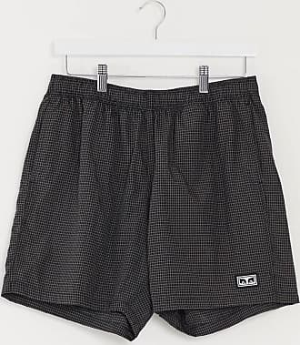 Obey Nore check shorts with badge in black