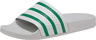 """adidas Originals – Sandalen """"Adilette"""" aus Teddyplüsch in Braun mit Streifen"""