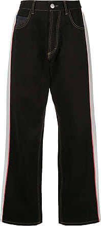 Koché Calça jeans com listra lateral - Preto
