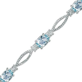 d29a0576c Zales Oval Blue Topaz and Diamond Accent Bracelet in Sterling Silver - 7.25