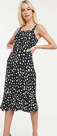 Warehouse cami dress with ruffle hem in spot print-Black