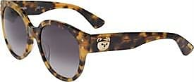 Moschino oversized tortoiseshell sunglasses with Moschino Teddy Bear metal appliqué at the beginning of the arm on both sides