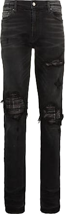 Amiri slim-fit distressed cotton and leather jeans - Black