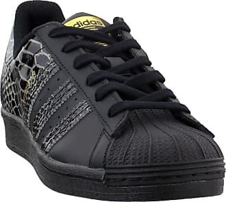 adidas Originals Womens Superstar Shoes Sneaker, Black/Black/Gold Metallic, 7.5
