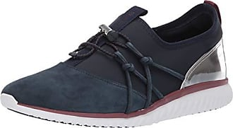 f84e577c0c Cole Haan Womens Studiogrand Freedom Sneaker, Blueberry Suede, 7 B US