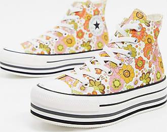 Converse Chuck Taylor - Knöchelhohe Sneaker mit mehrlagiger Plateausohle und Blumenprint, in Creme-Mehrfarbig