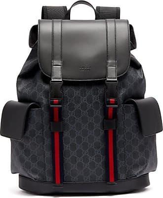 Gucci Sac à dos en cuir et toile Suprême GG