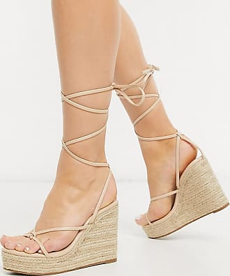 Glamorous espadrille wedge sandal with ankle tie in beige