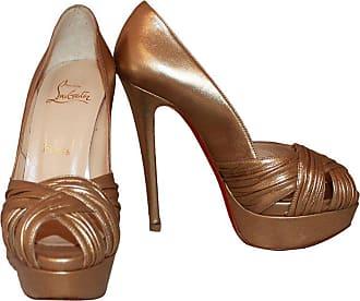 4906e36d6811 1stdibs Christian Louboutin Golden Platform Heels - 36
