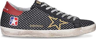 Golden Goose Superstar black and gold sneakers
