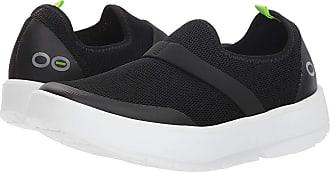 8a2e6675c5a Oofos Oomg (White Black) Womens Slip on Shoes. Oofos