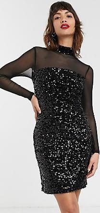 Mörkblå. En knälång klänning i krinklad chiffong. Klänningen