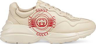 Gucci Rhyton Herren-Sneaker aus Leder mit Gucci Print