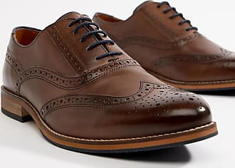 f497fa38a4e62 Asos Wide Fit brogue shoes in brown leather with natural sole and navy  details