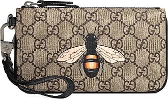 47cb22aa88 Gucci Pouch in tessuto GG Supreme con stampa ape