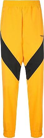 Yoshiokubo Calça esportiva com detalhe de listra - Amarelo