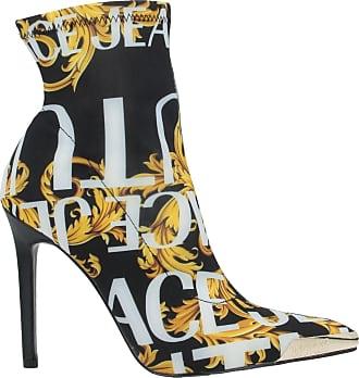 Versace CALZATURE - Stivaletti su YOOX.COM