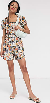 Warehouse daisy floral print belted shorts in multi
