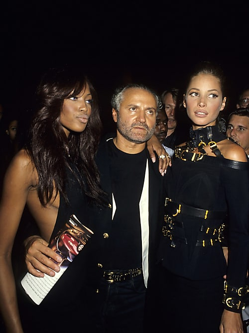 02b7376eca38 Gianni Versace was known for being flanked by multiple supermodels wherever  he went.