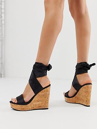 019d68d7d98c6b Asos Twist - Chaussures compensées en liège avec lien sur la jambe - Noir