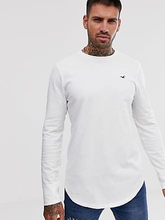 Hollister icon logo curved hem long sleeve top in white