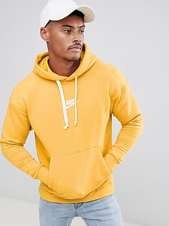 4aa9b11cd5d6 Nike Heritage Pullover Hoodie In Yellow 928437-752