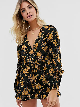 In The Style x Dani Dyer wrap front ruffle playsuit in black floral print-Multi