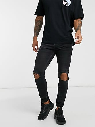 Topman stretch skinny jeans with blowout rips in washed black