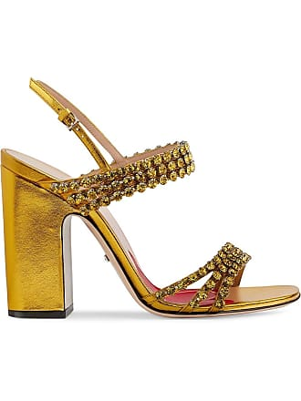 a9e57a94659 Gucci Metallic leather sandal with crystals - Gold