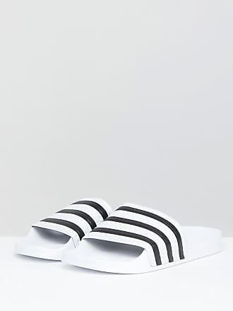 4a85df883bd8 adidas Originals Adilette Slider Sandals In White - White
