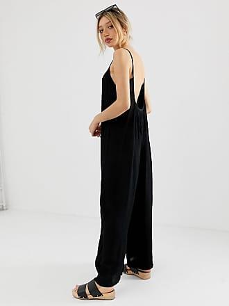db6f0423ed Asos Petite ASOS DESIGN Petite low back jumpsuit in crinkle - Black