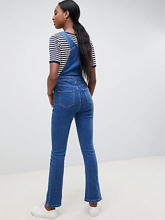 3269e003bec17 Asos Tall ASOS DESIGN Tall denim dungaree with kickflare in midwash blue -  Blue