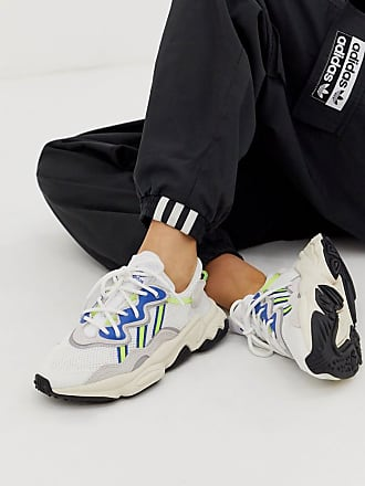 adidas Originals Ozweego trainers in white and blue