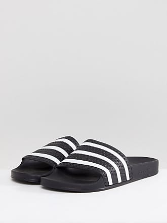 4255a6a6f adidas Originals Adilette Sliders In Black 280647 - Black