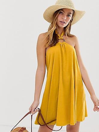 Asos Petite ASOS DESIGN Petite mini halter swing dress with faux tortoiseshell ring detail - Yellow