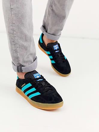 adidas Originals Gazelle trainers in black with gum sole
