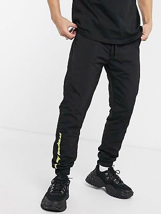 Pantalones de chándal de nailon con estampado en negro de Criminal Damage