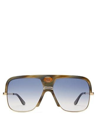 7f4eb57abca94 Gucci Lunettes de soleil en métal et acétate Navigator