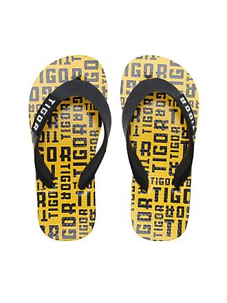 Tigor T. Tigre Chinelo Tigor T. Tigre Menino Logo Amarelo