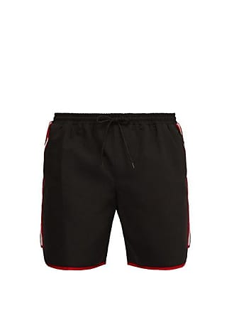 a9a9a584ff Gucci Tape Logo Swim Shorts - Mens - Black Multi