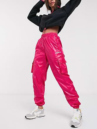 pantaloni adidas lucidi